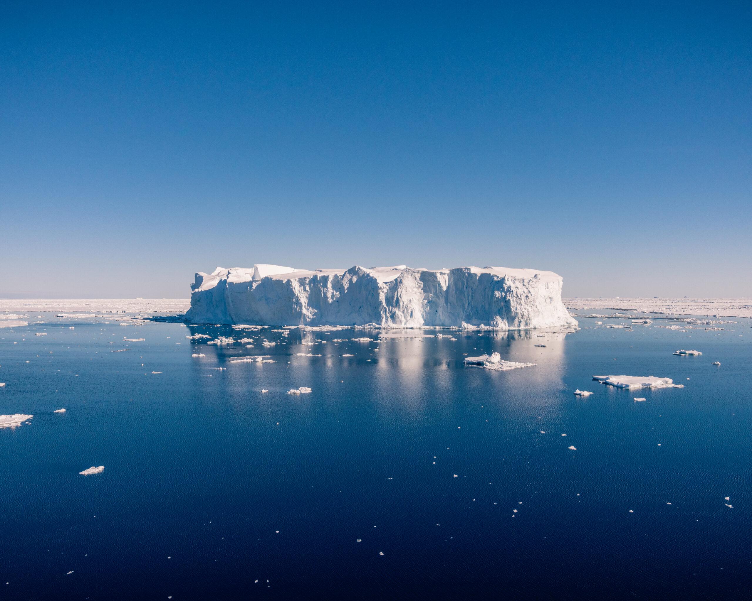 Iceberg on blue sea